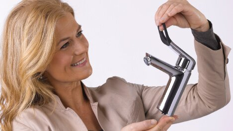 Woman holding the one handle tap