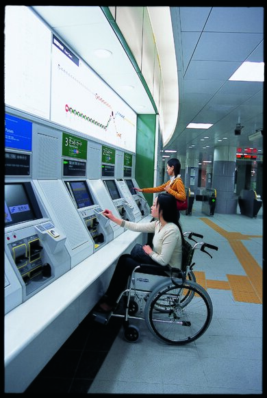ticket machine easily used by a woman in wheelchair