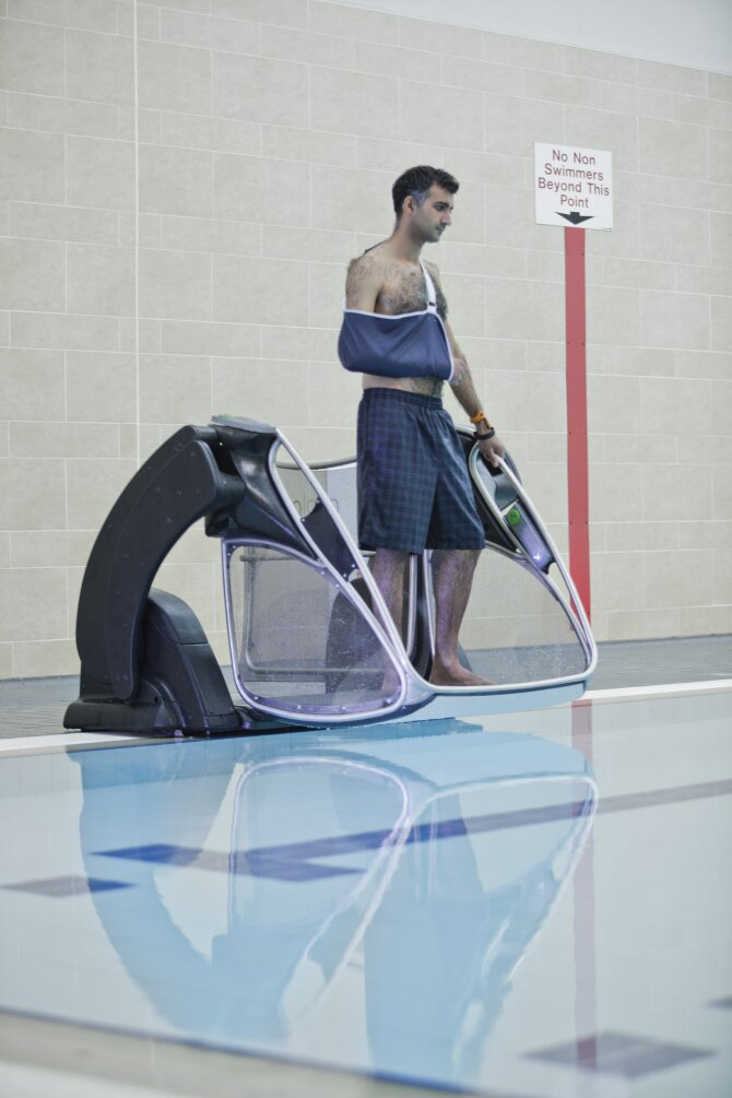 man with a broken arm accessing the pool